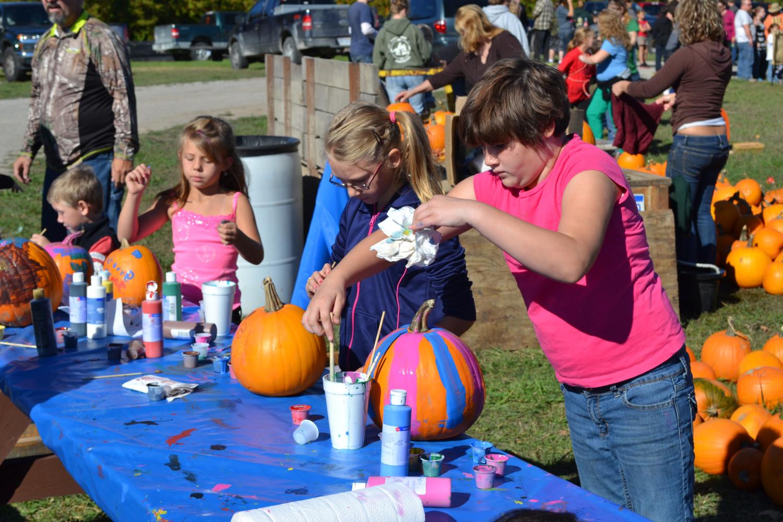Painting pumpkins.