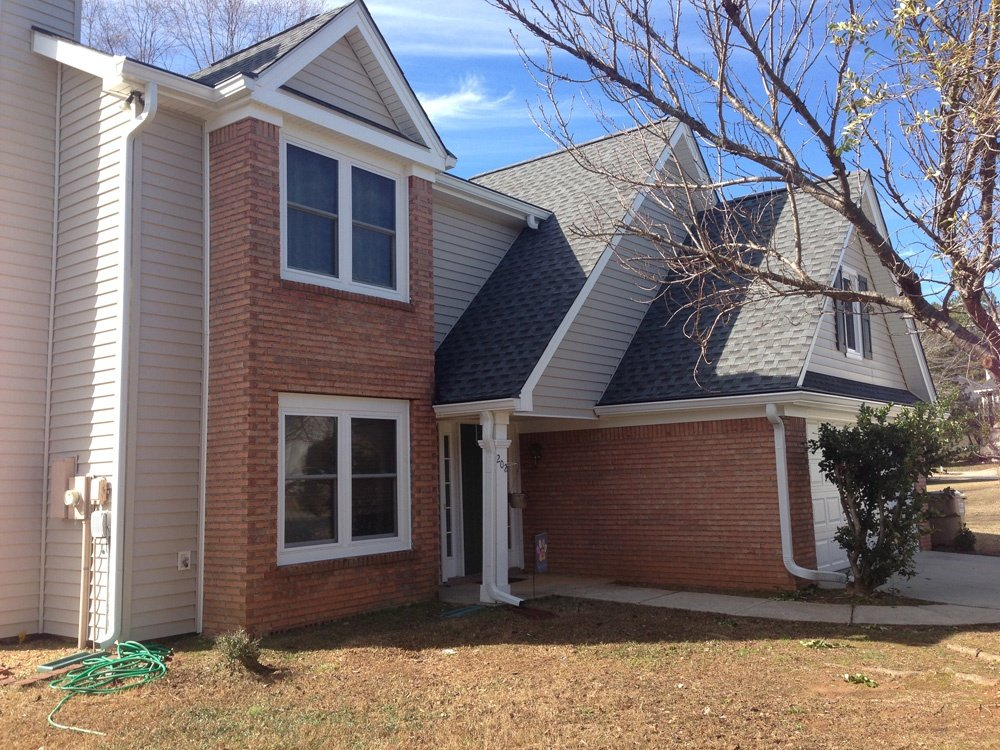Brick and Vinyl Siding