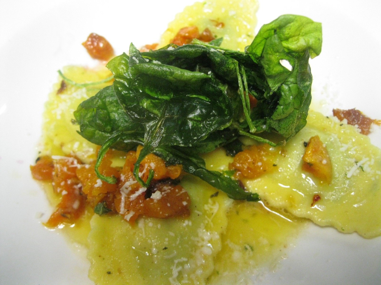 ricotta and nettle agnolotti with butternut squash and crisped baby spinach