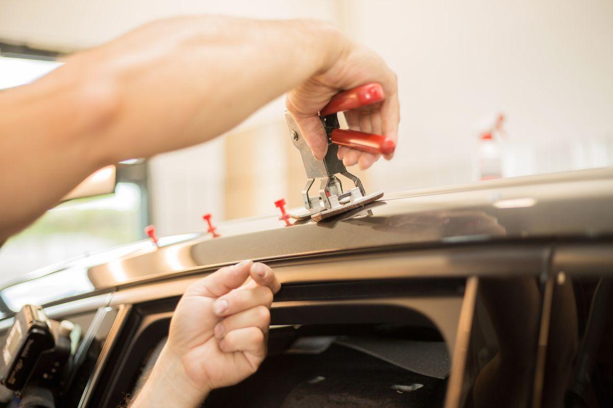 Repairing dents in a car