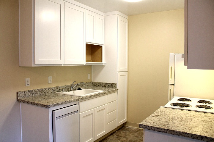Like this picture, the kitchen will have new granite countertops and new cabinets.