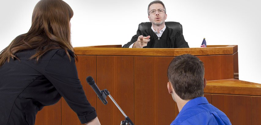 Defendant With Lawyer Speaking To A Judge
