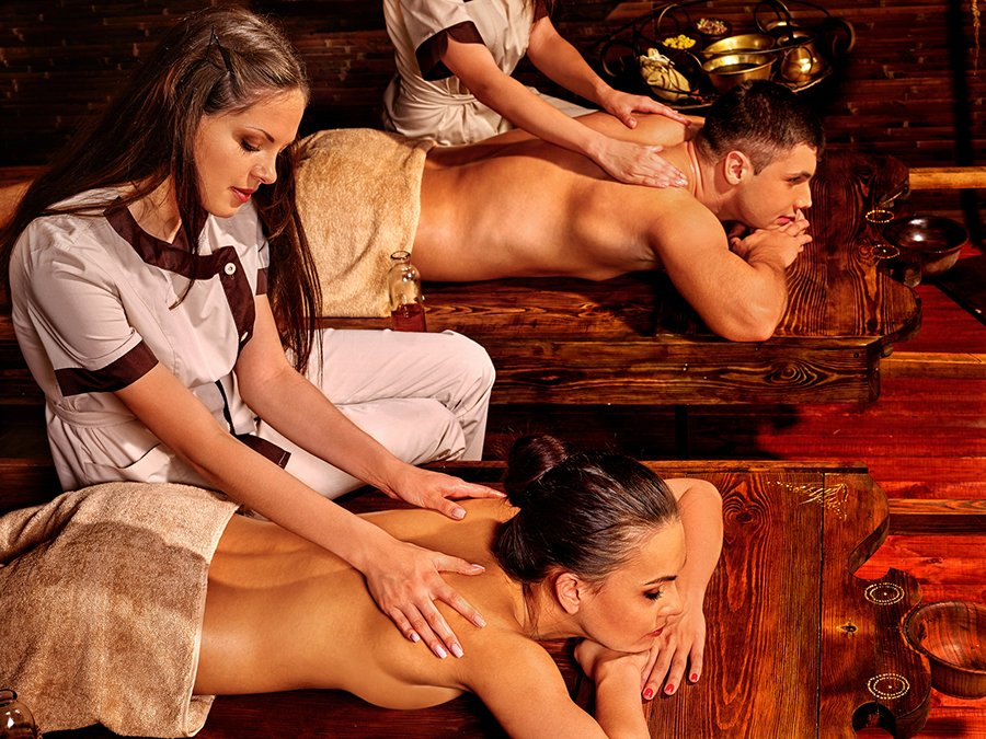 Couple having oil Ayurveda spa treatment
