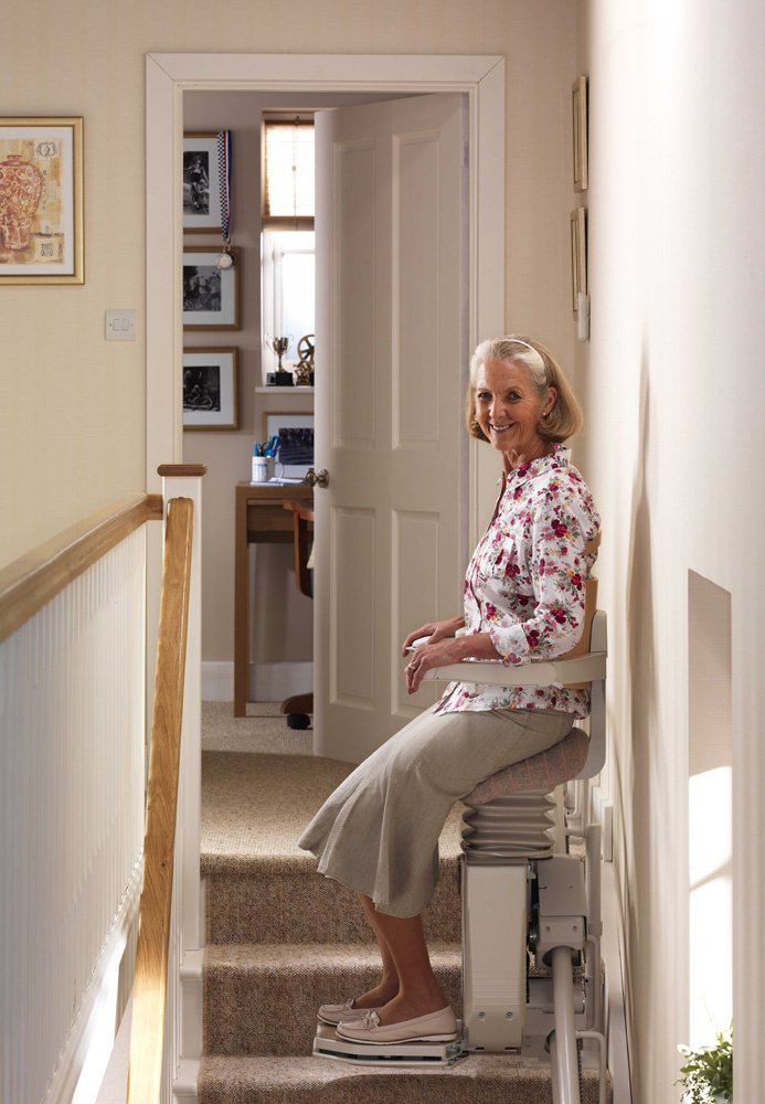 Women Sitting on a Stannah Stairlift