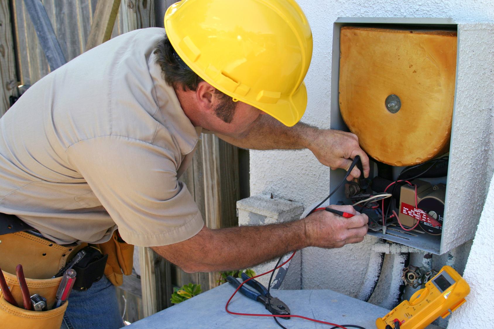 Technician fixing appliance