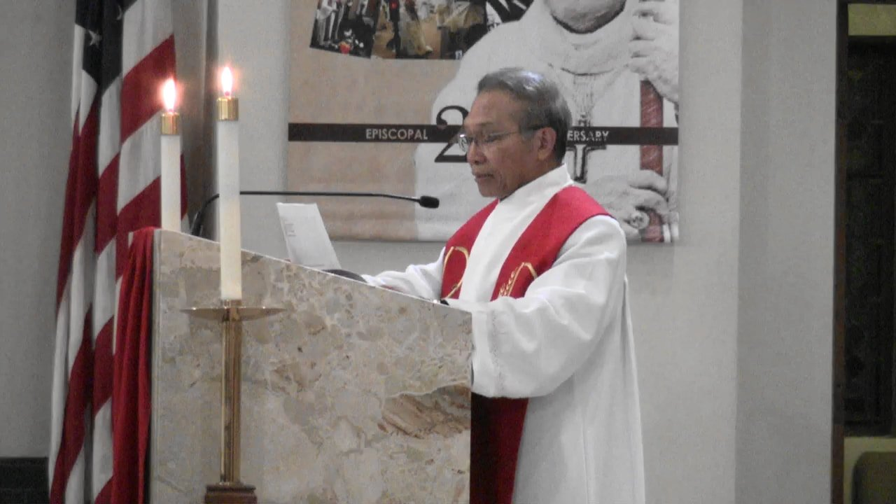 Priest preaching.