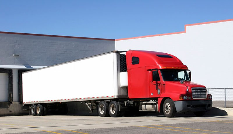 Tractor trailer sitting at a loading dock