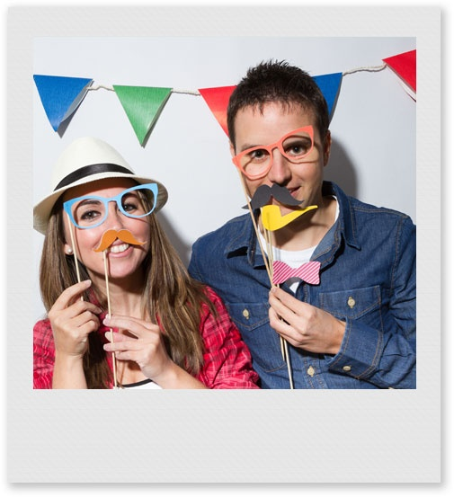 Young Couple in a Photo Booth