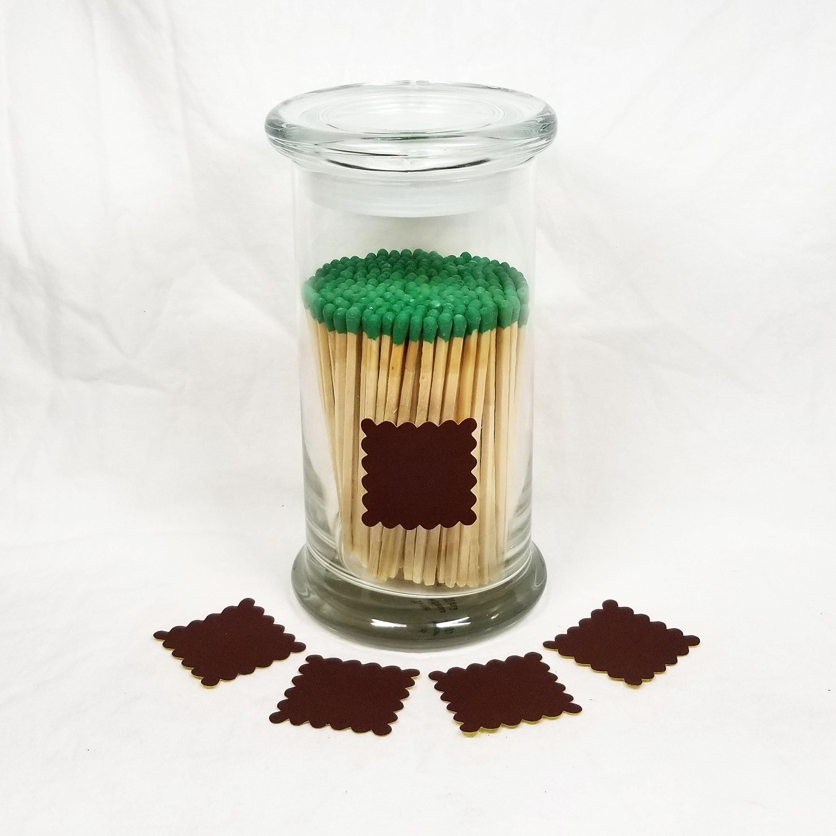 "Large Glass Status Jar with 4"" Matchsticks with Green Tips. Scalloped Square match striker in brown."