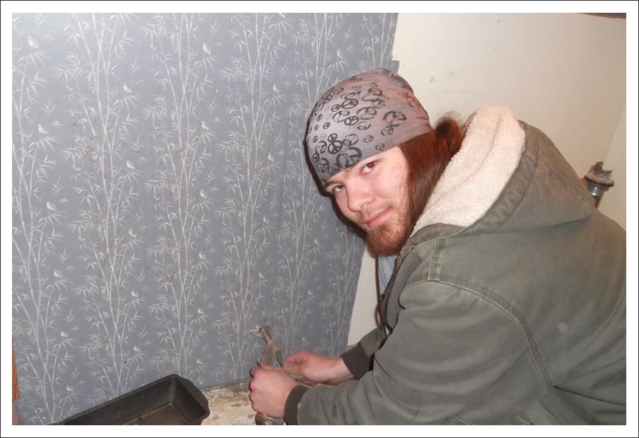 Plumber at work in bathroom    