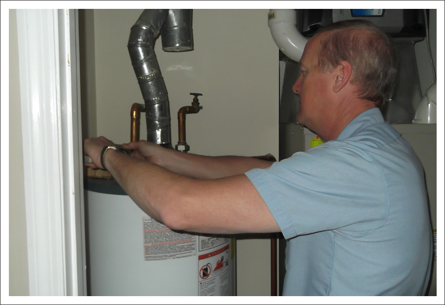 Plumber installing hot water heater||||