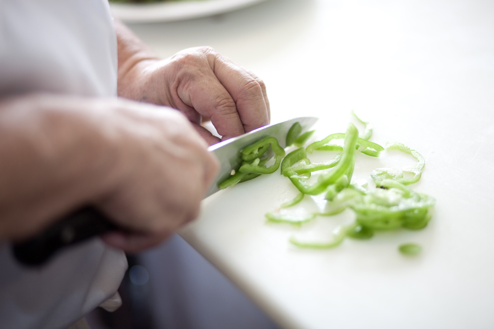 Chef slicing vegetable