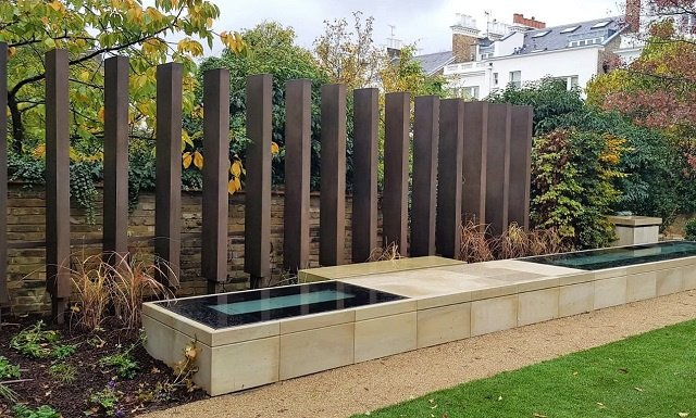 Metal coating in bronze. Private London garden. Artistic Metals.