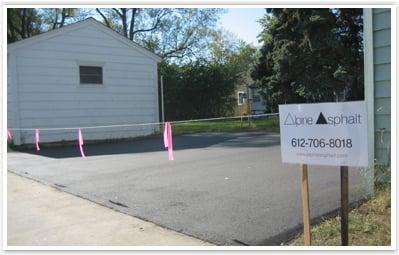 Residential asphalt driveway drying||||