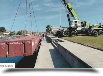Crane setting a barge||||