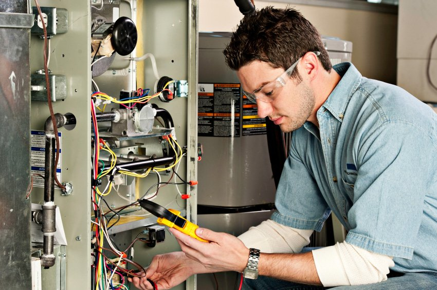 Service technician testing a furnace