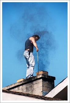 Young man cleaning the chimney||||