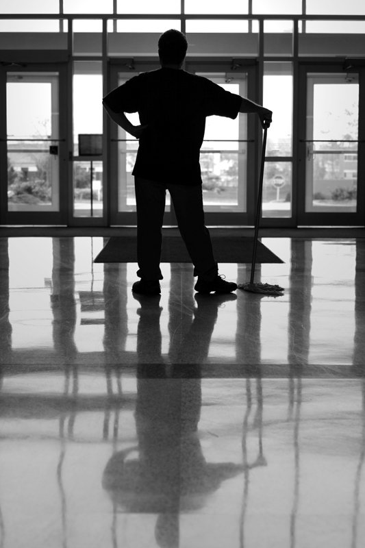 Man reflecting in clean floor||||