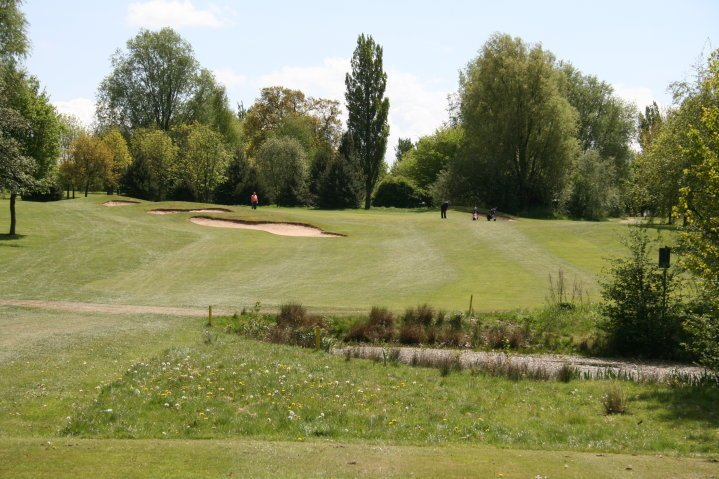 Hole 12: The Water Hole   The first par 3 on the back is 172 yards. Your tee shot is over a pond, uphill to a large green surrounded by bunkers. It might look simple but get it wrong and you'll find it tough to scrabble a par.
