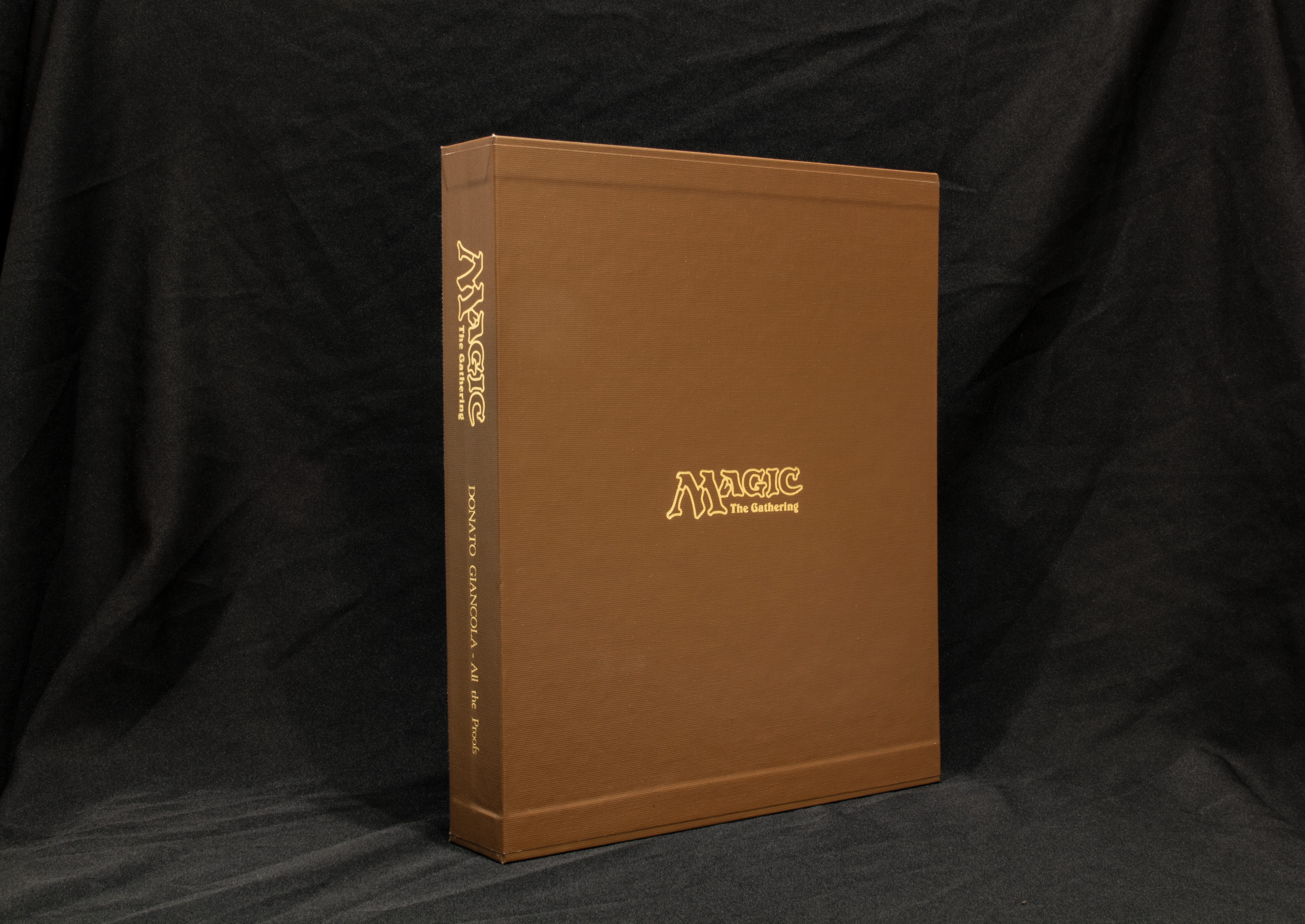 Archival and professionally embossed slipcase cover for protection of the leather binder and proofs Tan only