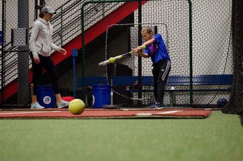Girl Hitting the Ball