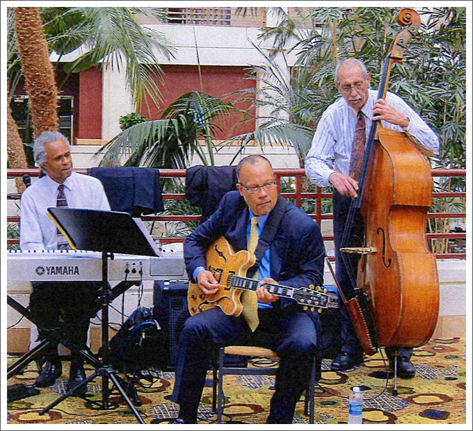 Three men playing instruments    