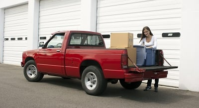 Woman unloading truck in front of storage unit