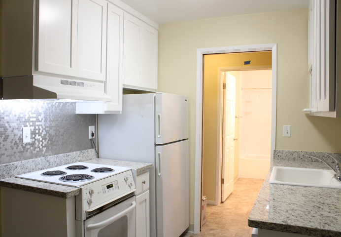 This kitchen has new cabinets with soft-closing hinges;  and new, granite countertops.