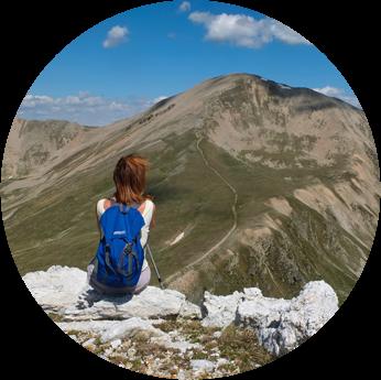 Girl with Backpack Enjoying  Mountains