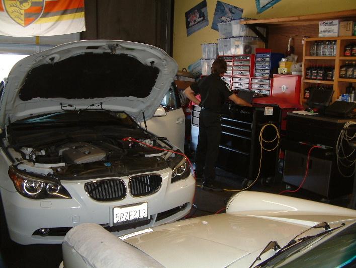 Repairing White Vehicle