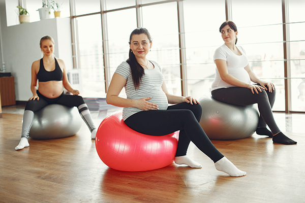 Young Pregnant Women During Fitness Workout