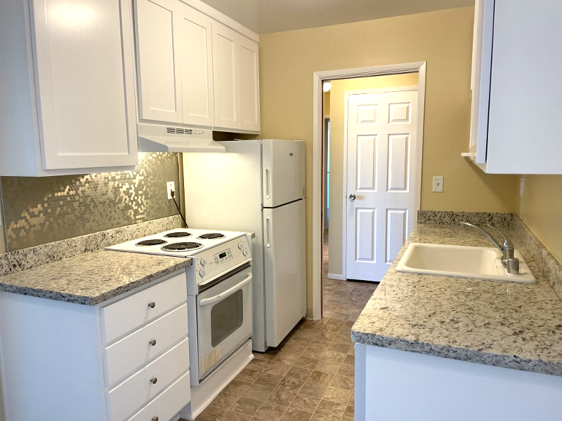 The kitchen has new, granite countertops, and new cabinets with soft-closing hinges.