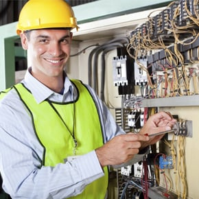 Technician Repairing Electrical Components