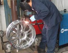 Guy welding rim