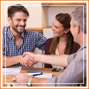 Couple Shaking Hand To Financial Agent