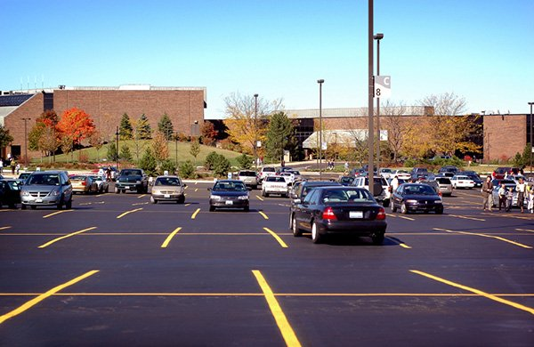 Parking lot with some cars