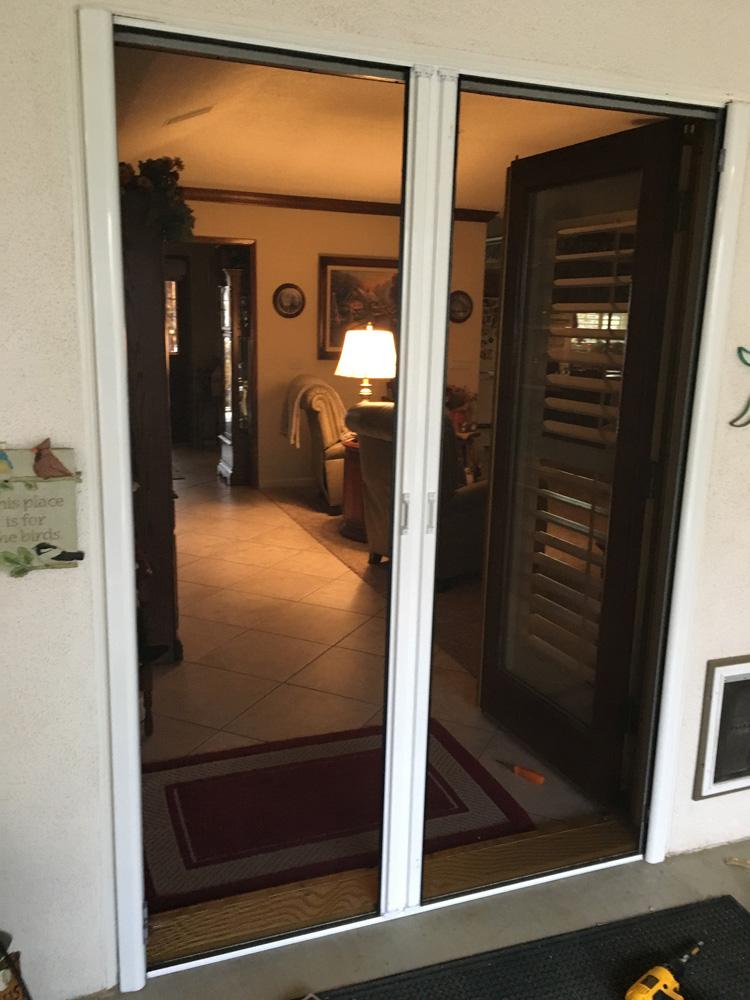 Roll away screens door for French doors or single door application