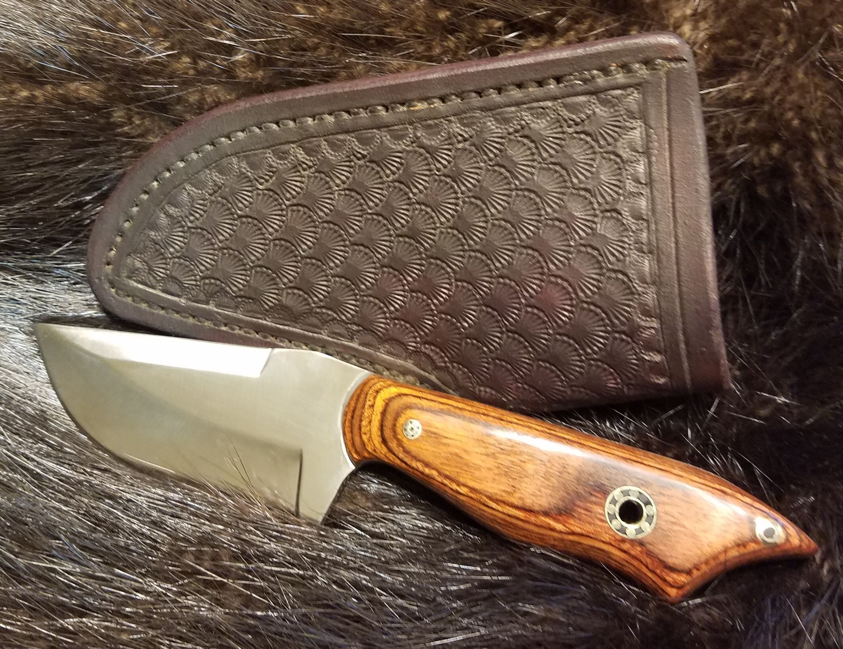Skinner, with Cocobolo Dymondwood handle, Hand tooled, hand stitched Leather Sheath,   $185.00