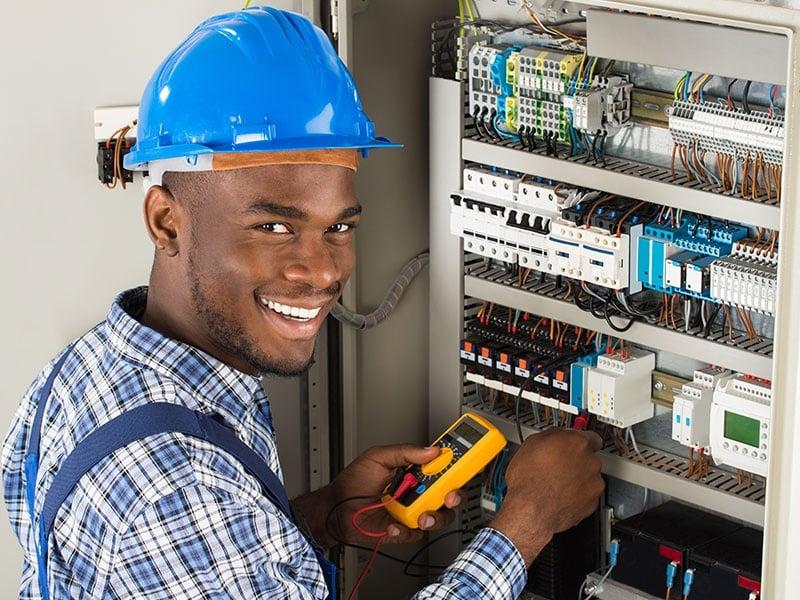 Technician Examining Fusebox