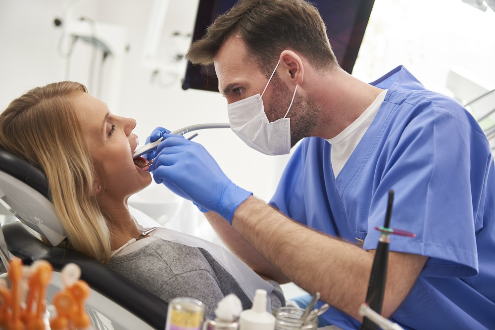 Dentist Works on Patient