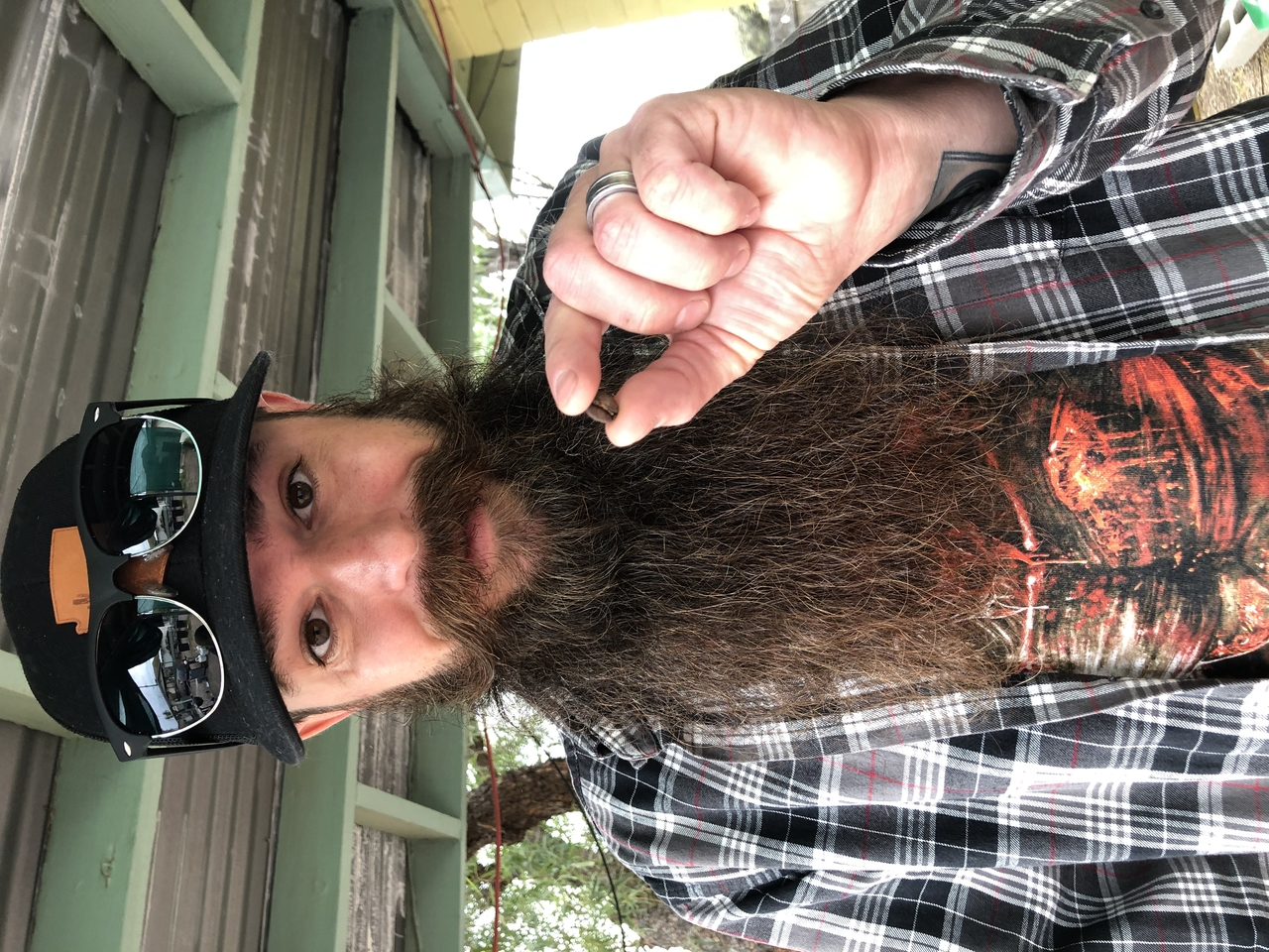 Matt DeVore, holding a single coffee bean