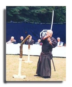 Nakamura Sensei performing tameshigiri at Meiji Shrine during the Japan Ancient Martial Arts Preservation Society's annual event on Culture Day. (Photo courtesy D. Skoss, copyright 1996,Koryu Books.)