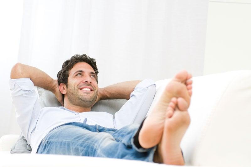 Man relaxing in sofa