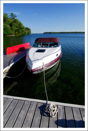 Boat tied at cottage dock||||