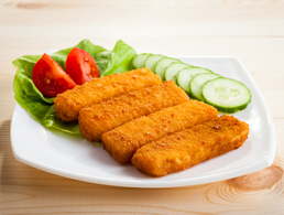 Fish Sticks with Vegetables on a White Plate