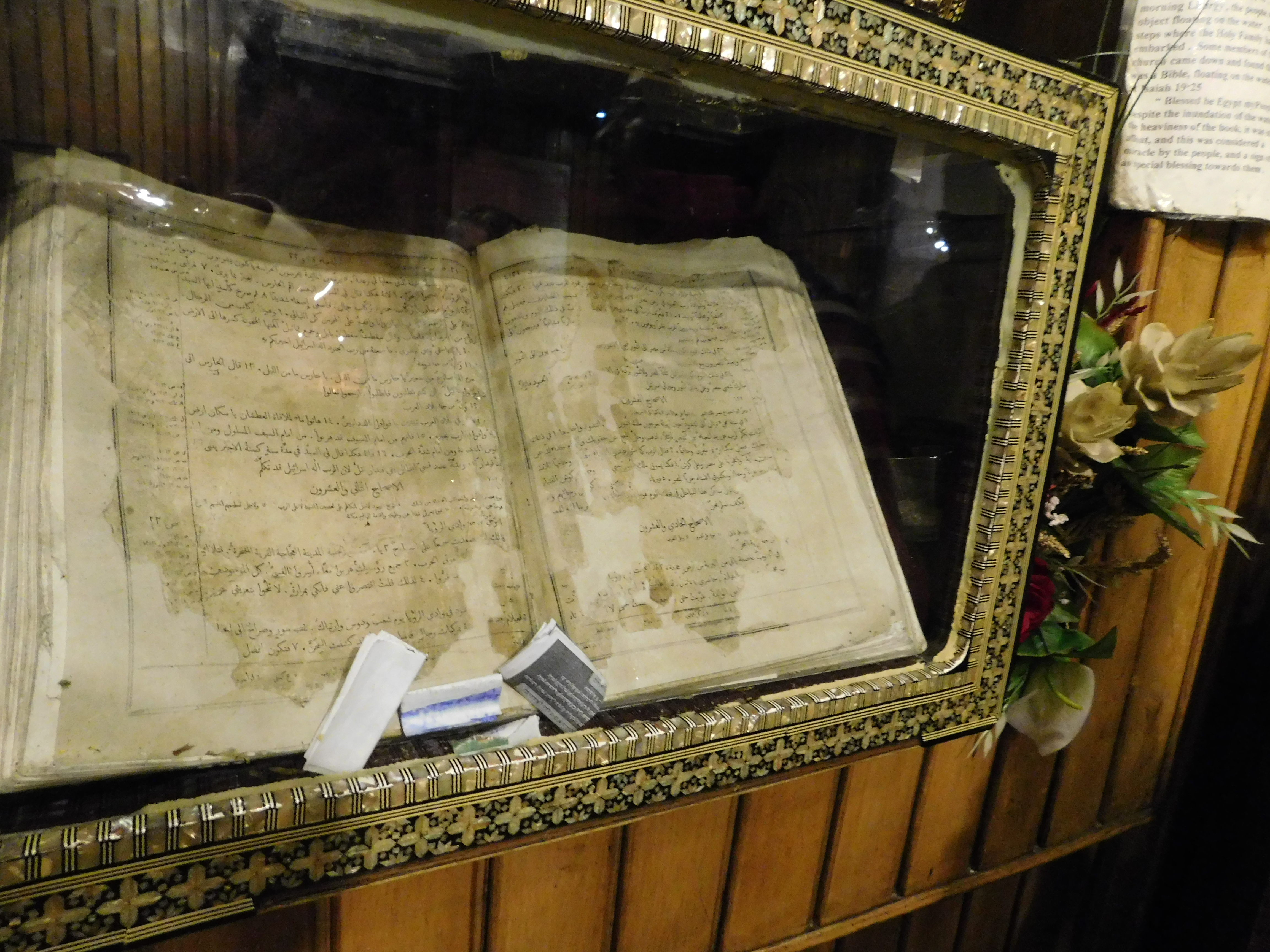 FLOATING BIBLE displayed at St. Mary Church open to  page that says I Love Egype my people