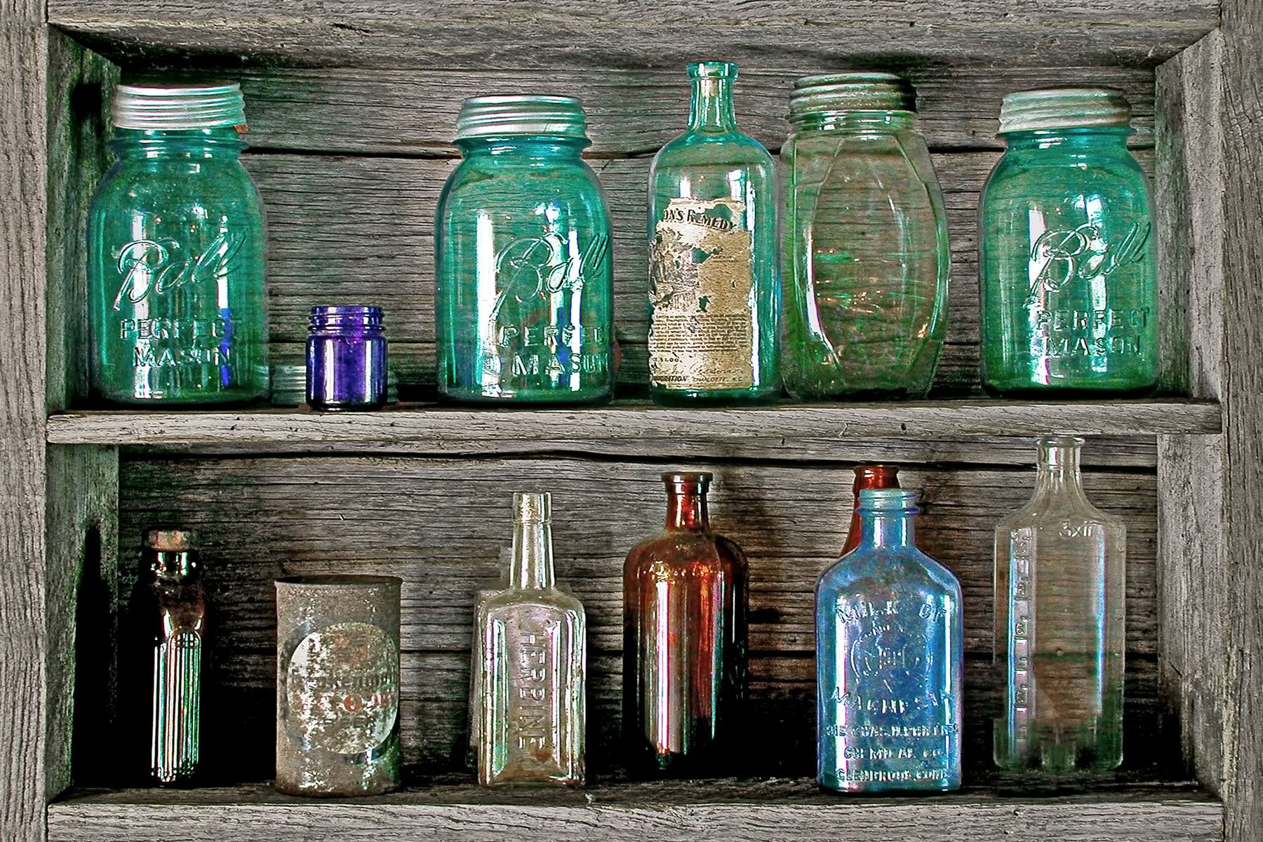 OLD JARS - These old jars were in a little museum in central Kentucky. I also photgraphed an old rocking chair in that same museum. You just never know.