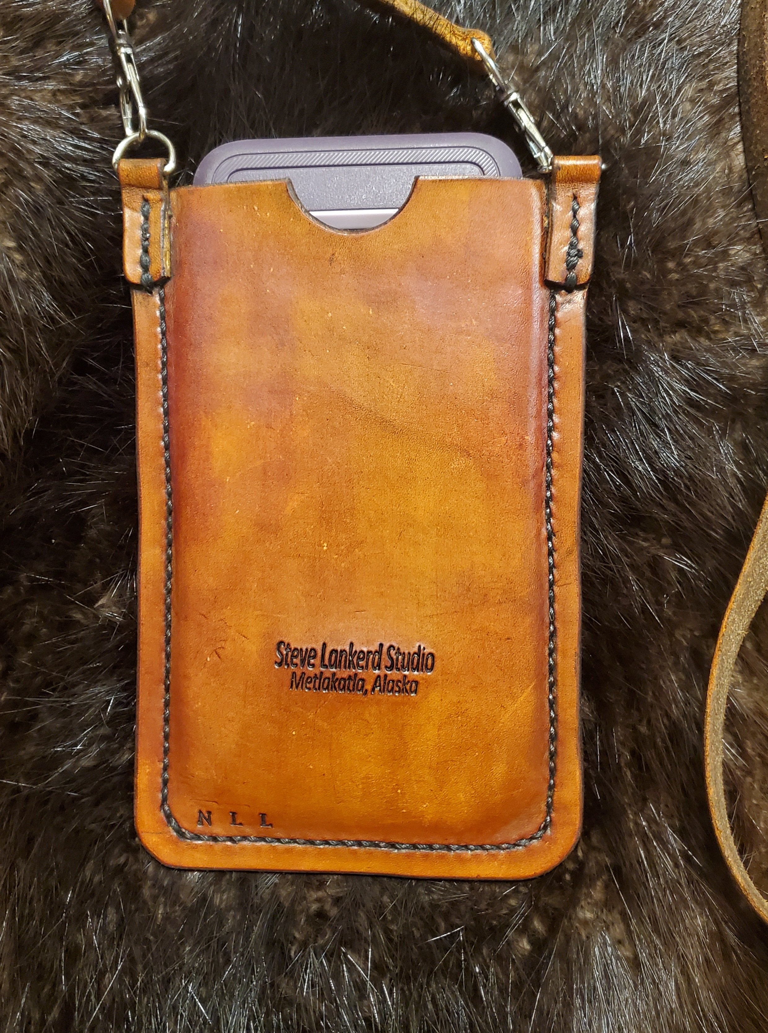 (Back)  Leather cell phone case with strap, hand tooled and hand stitched,  $85.00