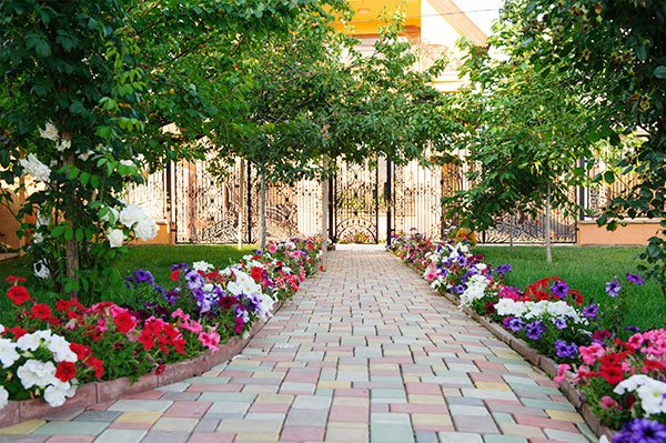 Colorful brick footpath with flowers