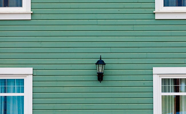 Exterior Wall Green Siding Center Lamp And Windows